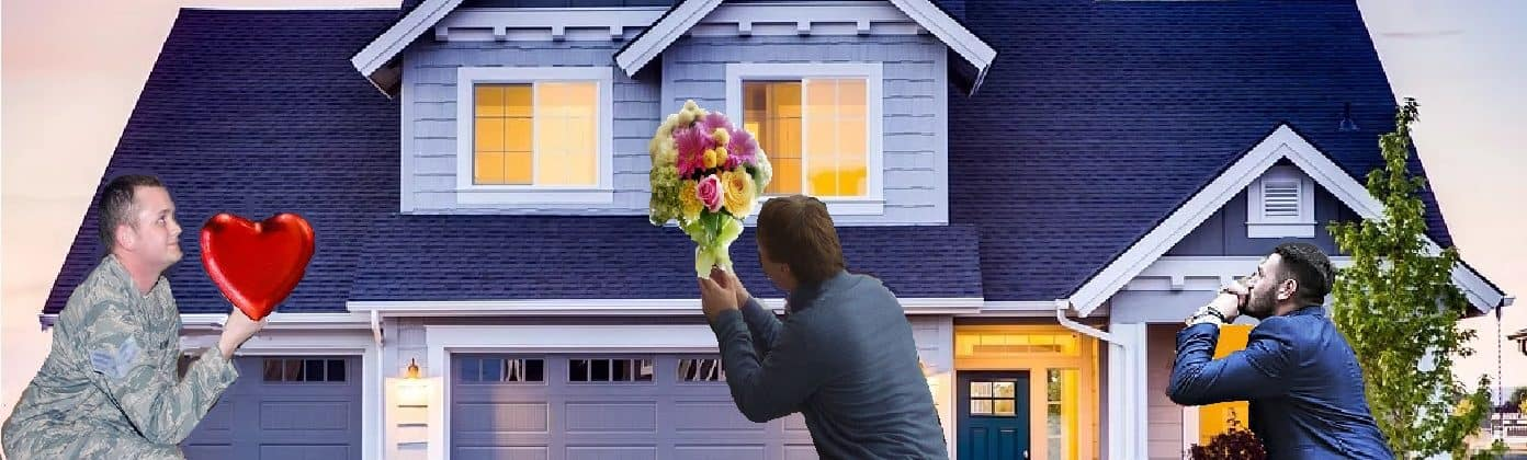 three men kneeling in front of a house, one holding a heart and the other is holding flowers